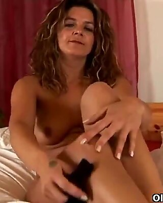 Elegant milf fucks herself with a dildo