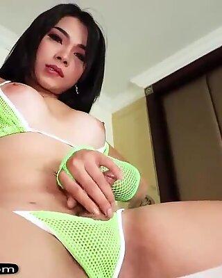 Ladyboy in a green bikini bareback fucked