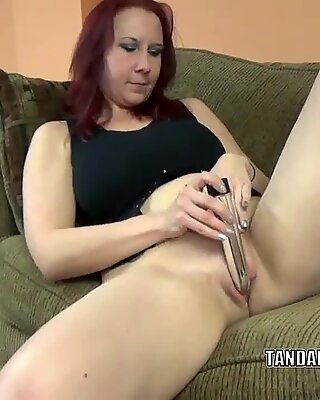Busty MILF Lia Shayde fucks her twat with a silver dildo