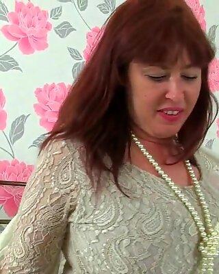 british cougar Janey jacks her unshaven pussy