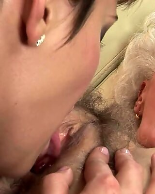 Sexy brunette grinds dripping pussy on old ladies face