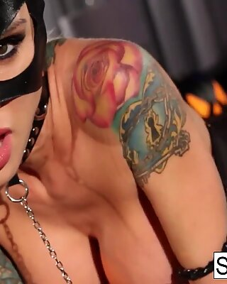 Catwoman gets a good fuckng from a tattooed stud