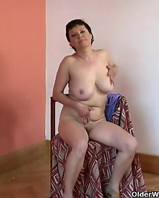 Hairy granny with big tits plays with dildo