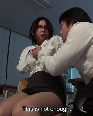 Horny Japanese teacher blows her students hairy dick