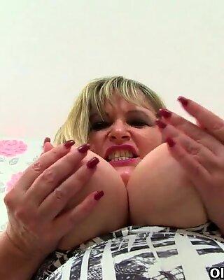 English gilf Auntie Trisha works her wet fanny with a dildo