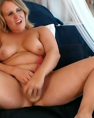 Chubby blonde mature babe with big tits plays with dildo